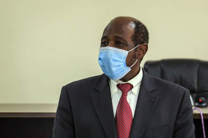 """Paul Rusesabagina appears in front of media at the headquarters of the Rwanda Bureau of investigations building in Kigali, Rwanda Monday, Aug. 31, 2020. Rusesabagina, who was portrayed in the film """"Hotel Rwanda"""" as a hero who saved the lives of more than 1,200 people from the country's 1994 genocide, and is a well-known critic of President Paul Kagame, has been arrested by the Rwandan government on terror charges, police announced on Monday, Aug. 31, 2020. (AP Photo)"""