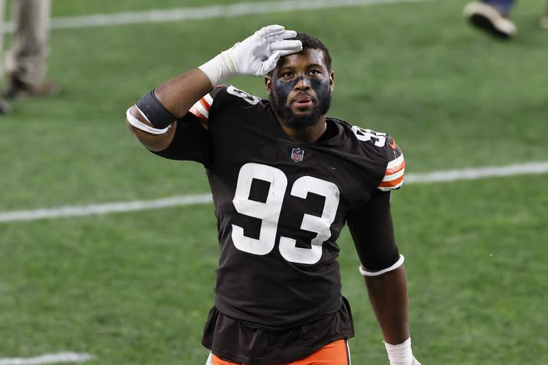 FILE - In this Oct. 11, 2020, file photo, Cleveland Browns middle linebacker B.J. Goodson (93) celebrates after the Browns defeated the Indianapolis Colts 32-23 during an NFL football game, in Cleveland. The Browns will try to earn a playoff spot without starting linebacker B.J. Goodson, who will miss the game on Sunday, Dec. 27, against the New York Jets after testing positive for COVID-19. (AP Photo/Ron Schwane, File)