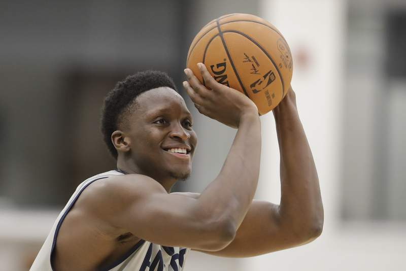 FILE - In this Jan. 28, 2020, file photo, Indiana Pacers' Victor Oladipo shoots during practice at the team's NBA basketball training facility in Indianapolis.  Oladipo was rounding into form when the NBA suddenly stopped. His expected increase in playing time, his hopes of chasing a home playoff series and taking the Indiana Pacers on a deep postseason run went on hold  at least a few more weeks. (AP Photo/Darron Cummings, File)