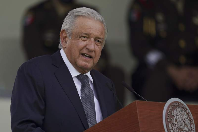 FILE - In this Aug. 13, 2021 file photo, Mexican President Andres Manuel Lopez Obrador speaks during a military parade introducing the new army commander in Mexico City. The SUV carrying Lpez Obrador was stopped and surrounded by a teachers group Friday, Aug. 27, 2021 in the southern state of Chiapas, preventing him from leading his usual daily morning news conference. (AP Photo/Fernando Llano, File)