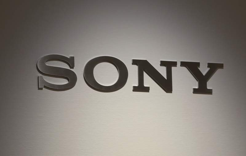 FILE - This Nov. 15, 2018, file photo shows the logo of Sony at its showroom in Tokyo. Sony Corp. is making its financial services unit a wholly owned subsidiary to ensure stability as the Japanese entertainment and electronics company seeks to ride out the financial woes brought on by the new coronavirus pandemic.  (AP Photo/Koji Sasahara, File)