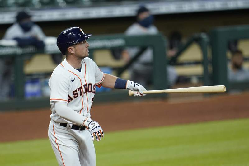 Houston Astros' Alex Bregman watches his three-run home run against the Seattle Mariners during the third inning of a baseball game Monday, July 27, 2020, in Houston. (AP Photo/David J. Phillip)