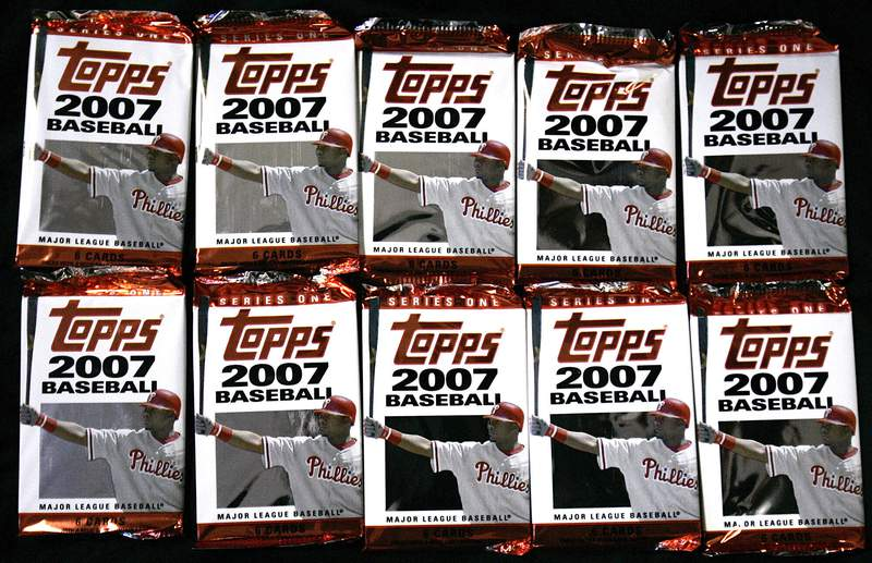 FILE - In this March 6, 2007 file photo, Topps baseball cards are seen in Boston.   Sports trading card company Topps is combining with a special purposes acquisition company in a deal valued at $1.3 billion and seeking a public listing. Topps Co. said Tuesday, April 6, 2021,  that it will join with Mudrick Capital Acquisition Corp., which will make a $250 million investment.   (AP Photo/Chitose Suzuki, file)
