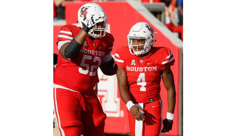 FILE - HOUSTON, TX - OCTOBER 27: D'Eriq King #4 of the Houston Cougars celebrates with Braylon Jones #52 after running in a 36 yard touchdown in the third quarter on October 27, 2018 in Houston, Texas. (Photo by Bob Levey/Getty Images)