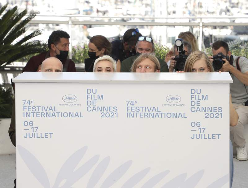 Yury Kolokolnikov, from left, Chulpan Khamatova, Ivan Dorn, and Yulia Peresild pose for photographers at the photo call for the film 'Petrov's Flu' at the 74th international film festival, Cannes, southern France, Tuesday, July 13, 2021. (Photo by Vianney Le Caer/Invision/AP)