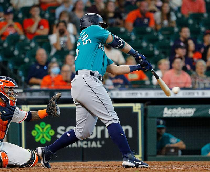 HOUSTON, TEXAS - SEPTEMBER 08: Jose Marmolejos #26 of the Seattle Mariners singles in two runs the ninth inning against the Houston Astros at Minute Maid Park on September 08, 2021 in Houston, Texas. (Photo by Bob Levey/Getty Images)