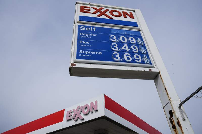 This April 28, 2021 photo shows an Exxon service station sign in Philadelphia.  Exxon Mobil reported profits of $4.69 billion in the second quarter, Friday, July 30, when demand for fuel recovered from lows reached earlier in the pandemic. The oil giant brought in $67.74 billion in revenue, more than double the amount at the same time last year.   (AP Photo/Matt Rourke)