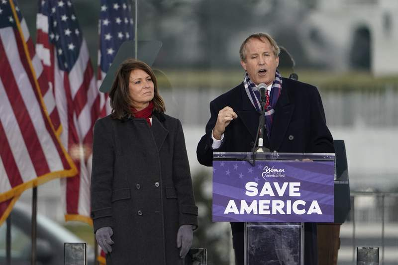 """FILE - In this Jan. 6, 2021 file photo, Texas Attorney General Ken Paxton speaks at a rally in support of President Donald Trump called the """"Save America Rally"""" in Washington. Lawyers for Texas' embattled attorney general have asked the state bar association to drop its investigation into whether the Republican's failed efforts to overturn the 2020 presidential election amounted to professional misconduct, arguing the probe is an unconstitutional overreach.(AP Photo/Jacquelyn Martin File)"""