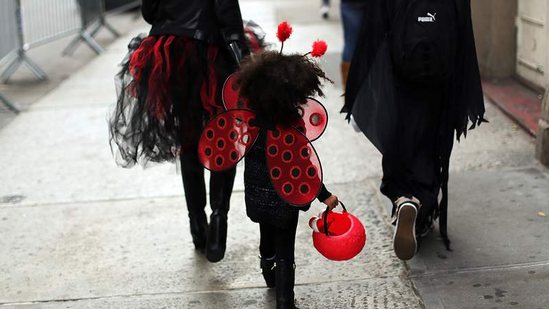 A child walks down a street in a Halloween costume on October 31, 2015 in New York City.