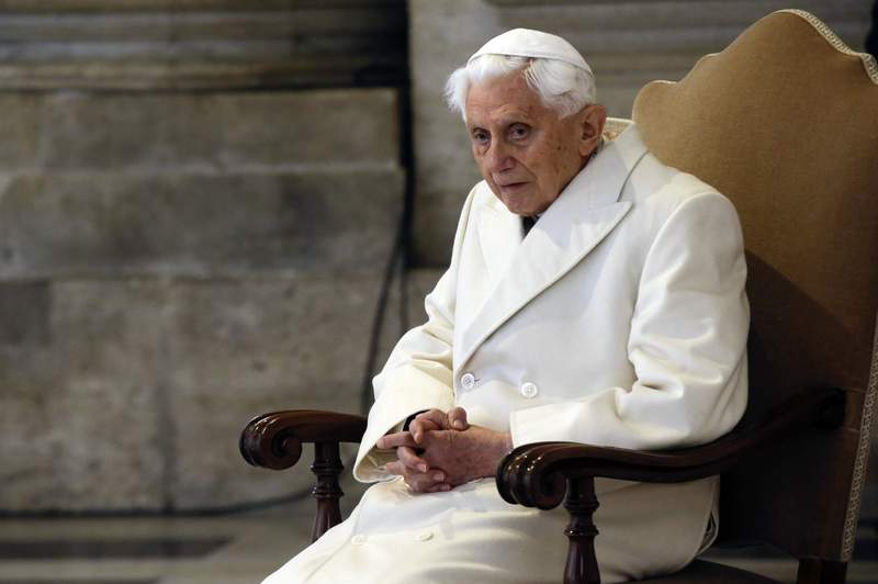 FILE - In this Tuesday, Dec. 8, 2015. filer, Pope Emeritus Benedict XVI attends a Mass prior to the opening of the Holy Door of St. Peter's Basilica, formally starting the Jubilee of Mercy, at the Vatican. Emeritus Pope Benedict XVI has fallen ill after his return from a trip to his native Bavaria to visit his brother, who died a month ago, a German newspaper reported Monday. (AP Photo/Gregorio Borgia, File)