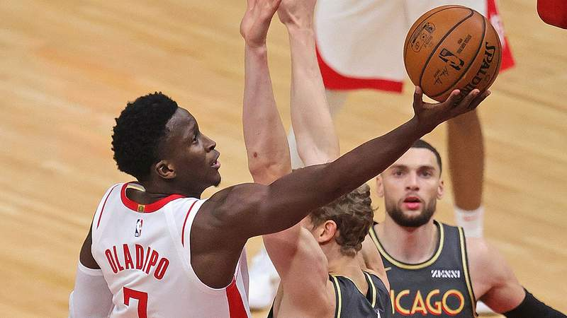 Victor Oladipo #7 of the Houston Rockets gets off a shot around Lauri Markkanen #24 of the Chicago Bulls at the United Center on January 18, 2021 in Chicago, Illinois. The Bulls defeated the Rockets 125-120.
