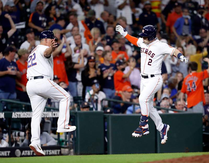 HOUSTON, TEXAS - SEPTEMBER 28: Celebration abounds at Minute Maid Park on September 28, 2021 in Houston, Texas. (Photo by Bob Levey/Getty Images)