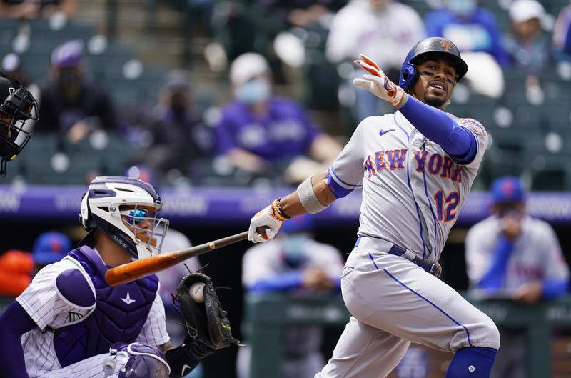 FILE - In this  Sunday, April 18, 2021 file photo, New York Mets' Francisco Lindor grounds out against Colorado Rockies starting pitcher Antonio Senzatela in the first inning of a baseball game in Denver. Francisco Lindor's contract negotiations with the Mets seemed pretty smooth. His swing certainly has not. The $341 million star shortstop entered Wednesday, April 28, 2021  batting .212 with three RBIs through 18 games with his new team and started hearing boos Tuesday night at Citi Field after grounding out late in a 2-1 loss to Boston.  (AP Photo/David Zalubowski, File)