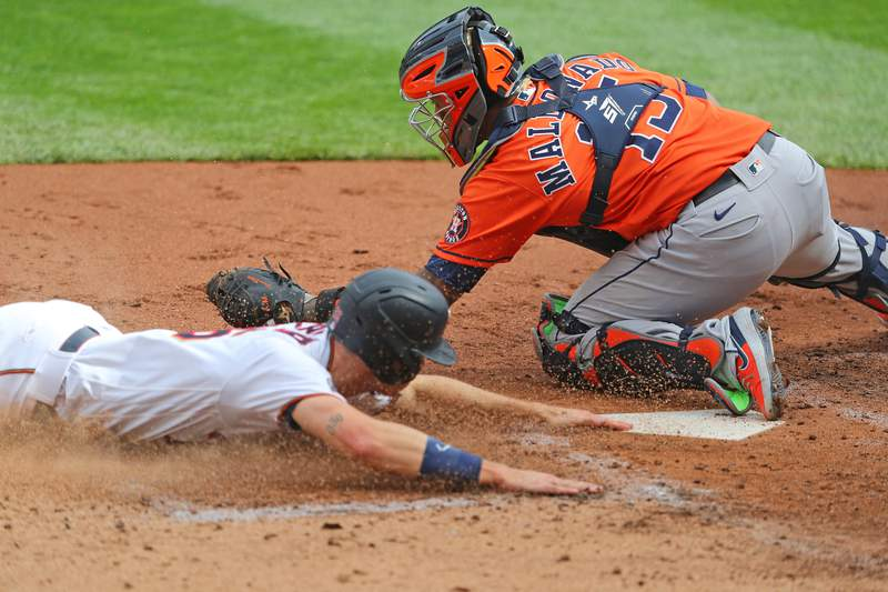 MINNEAPOLIS, MN - SEPTEMBER 29: Martin Maldonado #15 of the Houston Astros unsuccessfully attempts the tag on Max Kepler #26 of the Minnesota Twins allowing the first run of the game in the third inning during game one of the American League Wild Card series at Target Field on September 29, 2020 in Minneapolis, Minnesota. (Photo by Adam Bettcher/Getty Images)