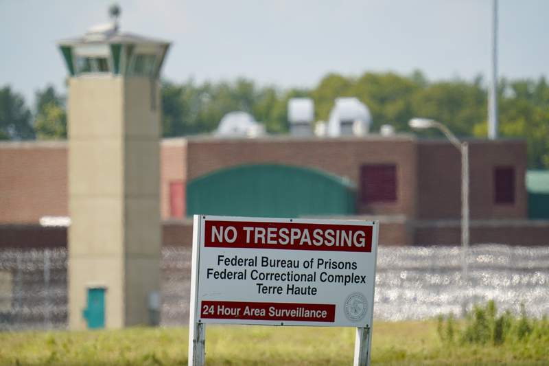 FILE - In this Aug. 26, 2020 file photo, the federal prison complex in Terre Haute, Ind., is shown Wednesday, Aug. 26, 2020. Dozens of civil rights and advocacy organizations are calling on the Biden administration to immediately halt federal executions after an unprecedented run of capital punishment under President Donald Trump. They want President Joe Biden to commute the sentences of inmates on federal death row.  (AP Photo/Michael Conroy)