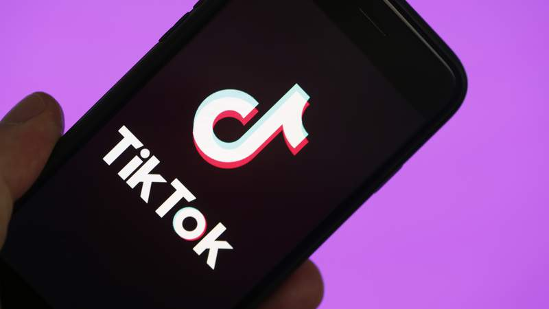 In this photo illustration, the social media application logo, TikTok is displayed on the screen of an iPhone on March 05, 2019 in Paris, France. (Photo by Chesnot/Getty Images)