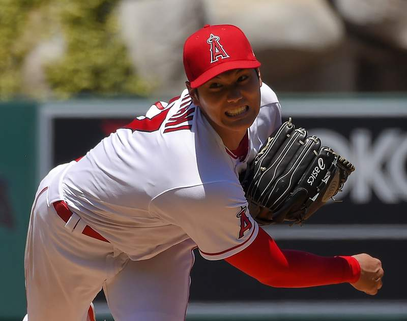 FILE - In this Aug. 2, 2020, file photo, Los Angeles Angels pitcher Shohei Ohtani, of Japan, throws during the second inning of a baseball game against the Houston Astros in Anaheim, Calif. Ohtani agreed to a two-year, $8.5 million contract with the Angels on Monday, Feb. 8, 2021, avoiding arbitration. (AP Photo/Mark J. Terrill, File)