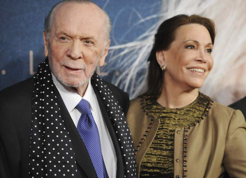 """FILE - In this Monday, Dec, 10, 2012 file photo, lyricist Herbert Kretzmer and his wife Sybil Sever attend the premiere for """"Les Miserables"""" at the Ziegfeld Theatre, in New York. Kretzmer, the journalist and lyricist best known for his English-language adaptation of the musical Les Misrables, has died. He was 95. His family confirmed Wednesday, Oct. 14, 2020 that Kretzmer had died of advanced effects of Parkinsons disease at his home in London with his Sybil by his side.  (Photo by Evan Agostini/Invision/AP, File)"""