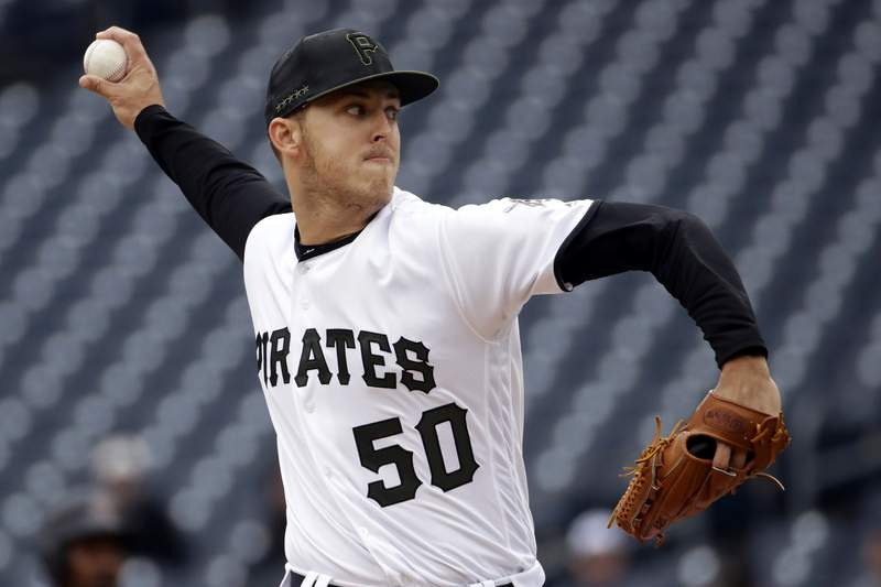 FILE - In this April 25, 2019, file photo, Pittsburgh Pirates starting pitcher Jameson Taillon delivers during the first inning of a baseball game against the Arizona Diamondbacks in Pittsburgh. A person familiar with the trade talks tells The Associated Press the New York Yankees made the second addition to their starting rotation of the offseason, agreeing to acquire right-hander Taillon from the Pirates for four prospects. (AP Photo/Gene J. Puskar, File)