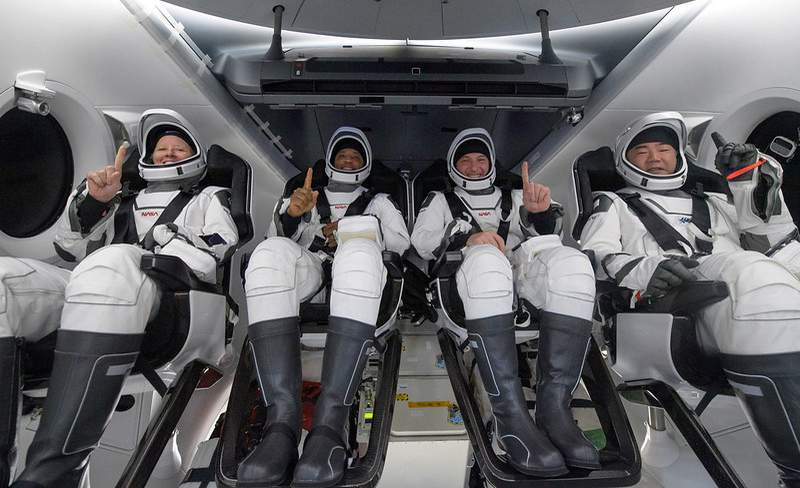 NASA astronauts Shannon Walker, left, Victor Glover, Mike Hopkins, and Japan Aerospace Exploration Agency (JAXA) astronaut Soichi Noguchi, right are seen inside the SpaceX Crew Dragon Resilience spacecraft onboard the SpaceX GO Navigator recovery ship shortly after having landed in the Gulf of Mexico off the coast of Panama City, Florida, Sunday, May 2, 2021. NASA's SpaceX Crew-1 mission was the first crew rotation flight of the SpaceX Crew Dragon spacecraft and Falcon 9 rocket with astronauts to the International Space Station as part of the agency's Commercial Crew Program.