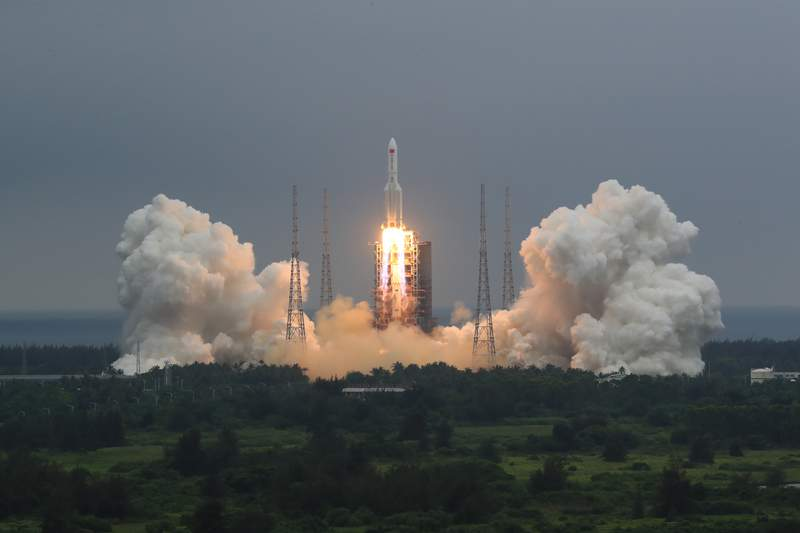FILE - In this April 29, 2021, file photo released by China's Xinhua News Agency, a Long March 5B rocket carrying a module for a Chinese space station lifts off from the Wenchang Spacecraft Launch Site in Wenchang in southern China's Hainan Province. The central rocket segment that launched the 22.5-ton core of China's newest space station into orbit is due to plunge back to Earth as early as Saturday in an unknown location. (Ju Zhenhua/Xinhua via AP, File)