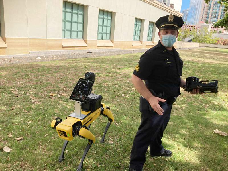 Honolulu Police Acting Lt. Joseph O'Neal demonstrates a robotic dog in Honolulu, Friday May 14, 2021. Police officials experimenting with the four-legged machines say they're just another tool, like drones or simpler wheeled robots, to keep emergency responders out of harm's way. (AP Photo/Jennifer Sinco Kelleher)