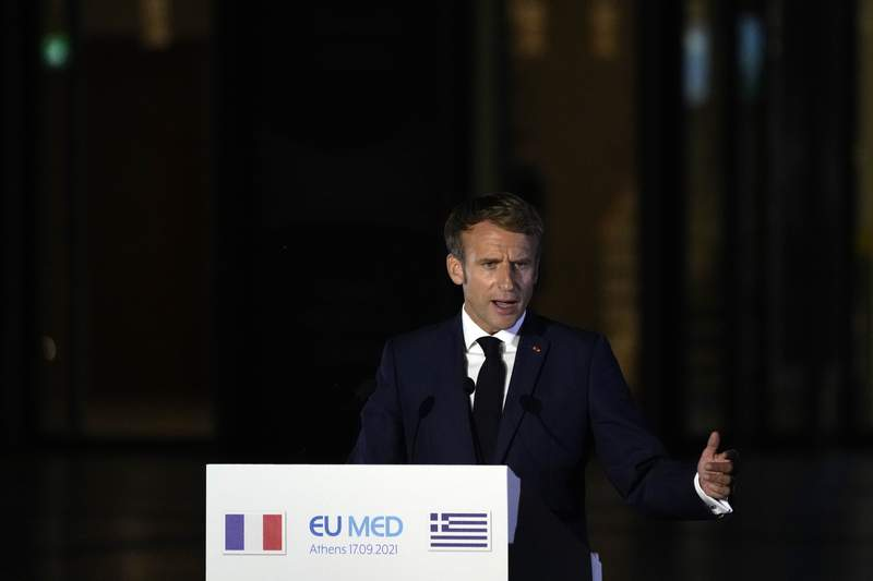 French President Emmanuel Macron makes statements during the EUMED 9 summit at the Stavros Niarchos Foundation Cultural Center in Athens, Friday, Sept. 17, 2021.The leaders of Europe's Mediterranean countries pledged Friday to expand cooperation against climate change, at a meeting in Athens held in the aftermath of massive wildfires that ravaged parts of southern Europe. (AP Photo/Thanassis Stavrakis)