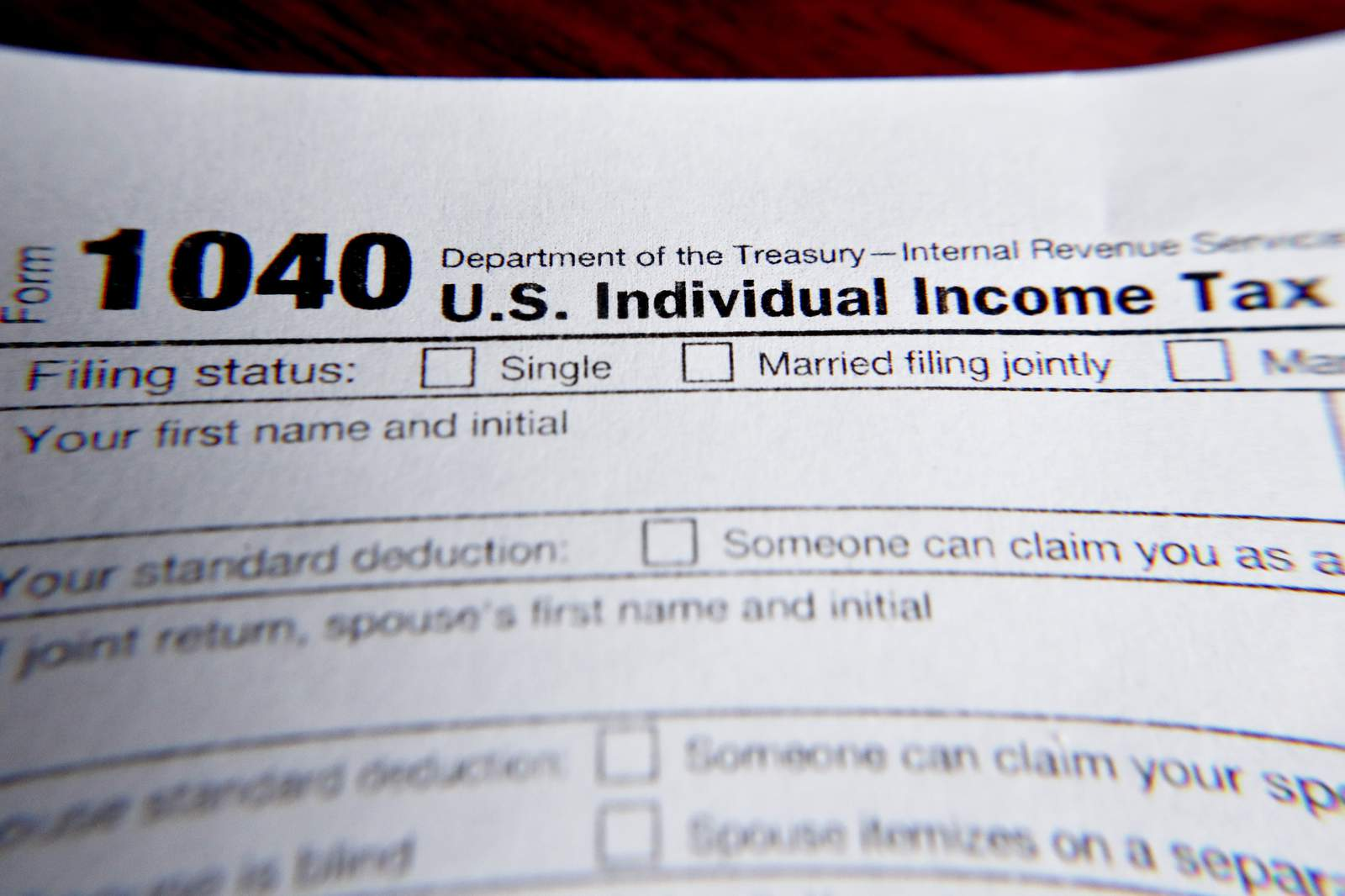 FILE - This Wednesday, Feb. 13, 2019 file photo shows part of a 1040 federal tax form printed from the Internal Revenue Service website, in Zelienople, Pa.  Tax filing season will start a bit later and look a bit different this year. Thats because the pandemic that defined 2020 has seeped into tax time as well. If you worked from home, received a relief payment, took on some gig work or filed unemployment benefits _ or someone filed a fake claim in your name _ there are things you need to be aware of. Likewise if you normally receive certain tax credits. The IRS will begin accepting tax returns on Feb. 12, 2021.  (AP Photo/Keith Srakocic, File)