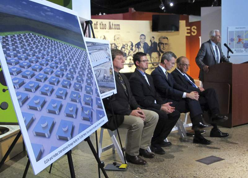 FILE - In this April 29, 2015, file photo, an illustration depicts a planned interim storage facility for spent nuclear fuel in southeastern New Mexico as officials announce plans to pursue a project by Holtec International during a news conference at the National Museum of Nuclear Science and History in Albuquerque, N.M. On Monday, March 29, 2021, New Mexico sued the U.S. Nuclear Regulatory Commission over concerns that the federal agency hasn't done enough to vet plans for a multibillion-dollar facility to store spent nuclear fuel in the state. New Jersey-based Holtec International wants to build a complex in southeastern New Mexico where tons of spent fuel from commercial nuclear power plants around the nation could be stored until the federal government finds a permanent solution. (AP Photo/Susan Montoya Bryan, File)