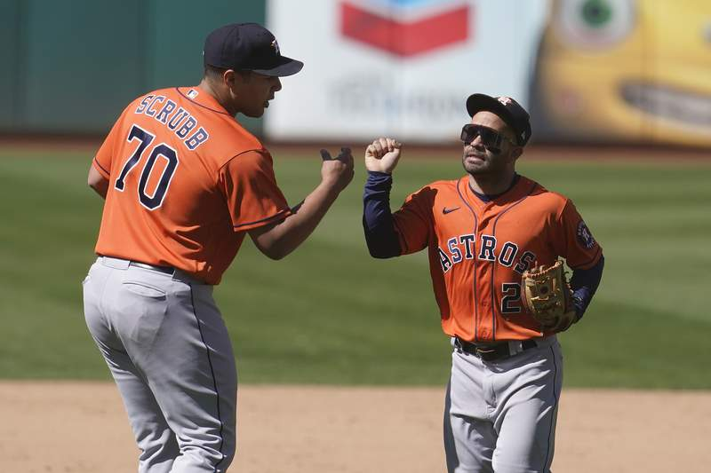 Houston Astros pitcher Andre Scrubb (70) celebrates with second baseman Jose Altuve after the Astros defeated the Oakland Athletics 8-4 in a baseball game in Oakland, Calif., Thursday, May 20, 2021. (AP Photo/Jeff Chiu)