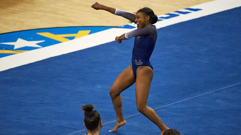 UCLA senior gymnast Nia Dennis performs a near-perfect floor routine with the stylings of Beyonce, Kendrick Lamar, and Missy Elliott last Saturday.