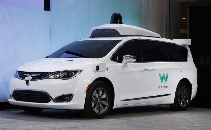 FILE - In this Jan. 8, 2017, file photo a Chrysler Pacifica hybrid outfitted with Waymo's suite of sensors and radar is displayed at the North American International Auto Show in Detroit.   The U.S. governments road safety agency is asking for public comment on how it should regulate safe deployment of self-driving vehicles.  NHTSA said Thursday, Nov. 19, 2020 it wants public input on potential regulation of autonomous vehicle sensors and other aspects of the technology.  (AP Photo/Paul Sancya, File)