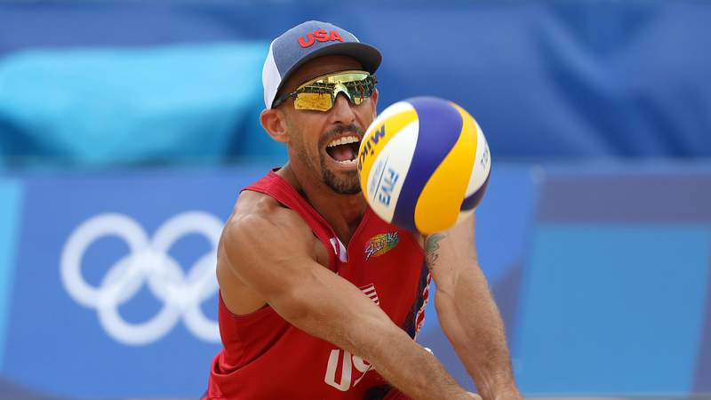 TOKYO, JAPAN - JULY 27: Nicholas Lucena #2 of Team United States returns against Team Brazil during the Men's Preliminary - Pool D beach volleyball on day four of the Tokyo 2020 Olympic Games at Shiokaze Park on July 27, 2021 in Tokyo, Japan