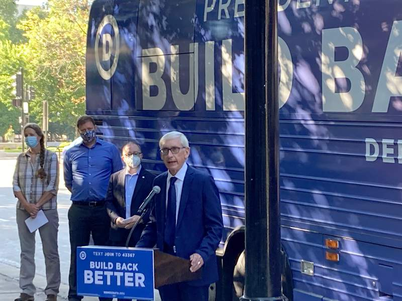 """Democratic Gov. Tony Evers said that it was """"outrageous"""" that Republicans planned to spend $680,000 on an investigation into the 2020 election in Wisconsin on Monday, Aug. 30, 2021, during a Democratic Party bus tour that stopped outside the state Capitol in Madison, Wisc. (AP Photo/Scott Bauer)"""