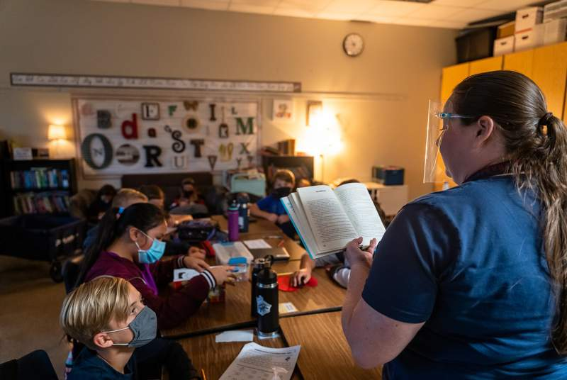 Teacher Melissa Perry reads to her fifth grade class at Jacobs Well Elementary School in Wimberley on September 4, 2020.