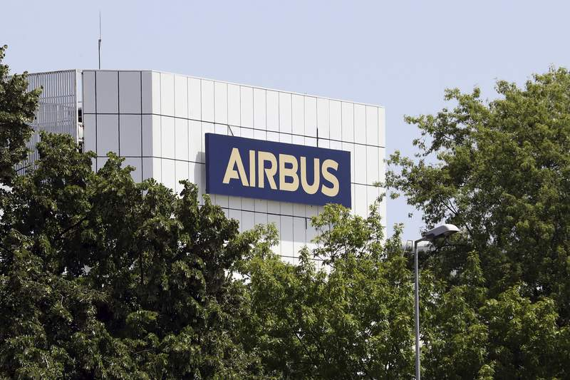 """FILE - In this Thursday, July 9, 2020 file photo, the logo of Airbus group is displayed in Toulouse, south of France. Struggling planemaker Airbus says new European virus lockdown measures are making its life a bit more difficult."""" It announced 1 billion euros ($1.16 billion) in COVID-related losses for the third quarter Thursday, Oct. 29, 2020 amid a slower-than-expected recovery in air travel. (AP Photo/Manuel Blondeau, file)"""
