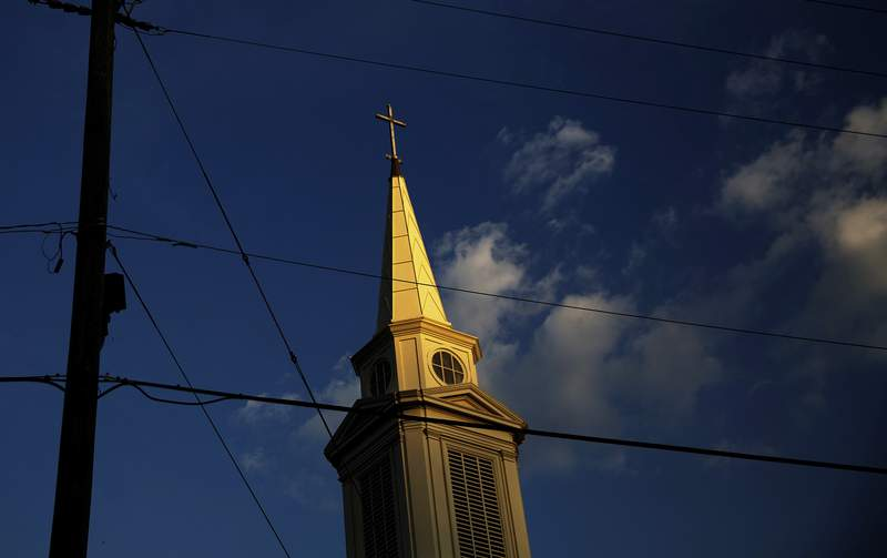 FILE - In this Tuesday, April 11, 2017 file photo, the sun sets on a Baptist church in Georgia.  For the first time since the late 1930s, fewer than half of Americans say they belong to a church, synagogue or mosque, according to a new report from Gallup, Tuesday, March 30, 2021.  (AP Photo/David Goldman)