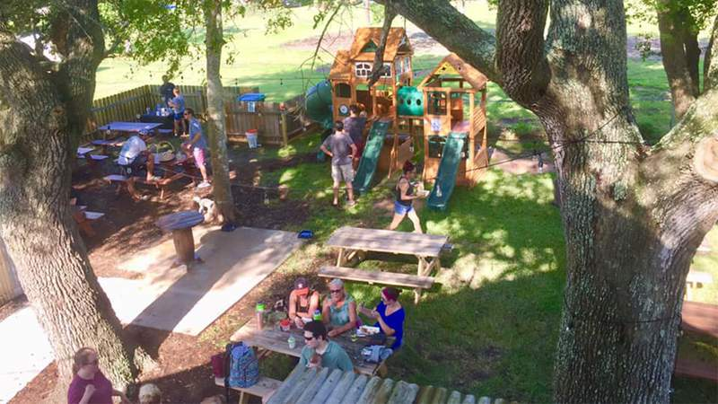 Families gather at Penny's Beer Garden in Dickinson, Texas on Aug. 19, 2019.