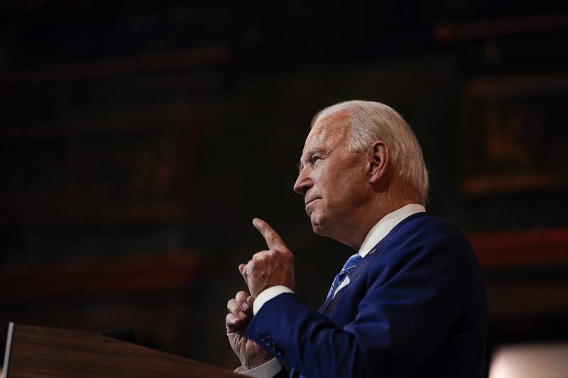 FILE - In this Nov. 25, 2020, file photo President-elect Joe Biden speaks in Wilmington, Del. In the years since Barack Obama and Biden left the White House, the tech industry's political fortunes have flipped. Facebook, Google, Amazon and Apple have come under scrutiny from Congress, federal regulators, state attorneys general and European authorities. (AP Photo/Carolyn Kaster, File)