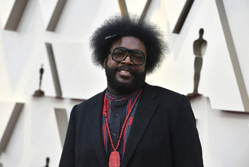 Questlove arrives at the Oscars on Sunday, Feb. 24, 2019, at the Dolby Theatre in Los Angeles. The founder of the hip-hop group The Roots wants to find the woman who bought a turntable and records for him when he was 5. He posted about his quest on social media over the weekend. He wrote that he was in Portland, Maine, in 1976 when he made friends with a stranger. He said he knew talking to strangers was a no-no but says my instincts paid off. Now he's hoping to find Ellie. (Photo by Jordan Strauss/Invision/AP)