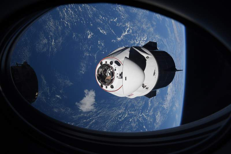 In this Saturday, April 24, 2021 photo made available by NASA, the SpaceX Crew Dragon capsule approaches the International Space Station for docking. SpaceX's four astronauts had barely settled into orbit on Friday, April 23, when they were ordered back into their spacesuits because of a potential collision with orbiting junk. It turns out there was no threat, the U.S. Space Command acknowledged Monday, April 26. The error is under review. (NASA via AP)