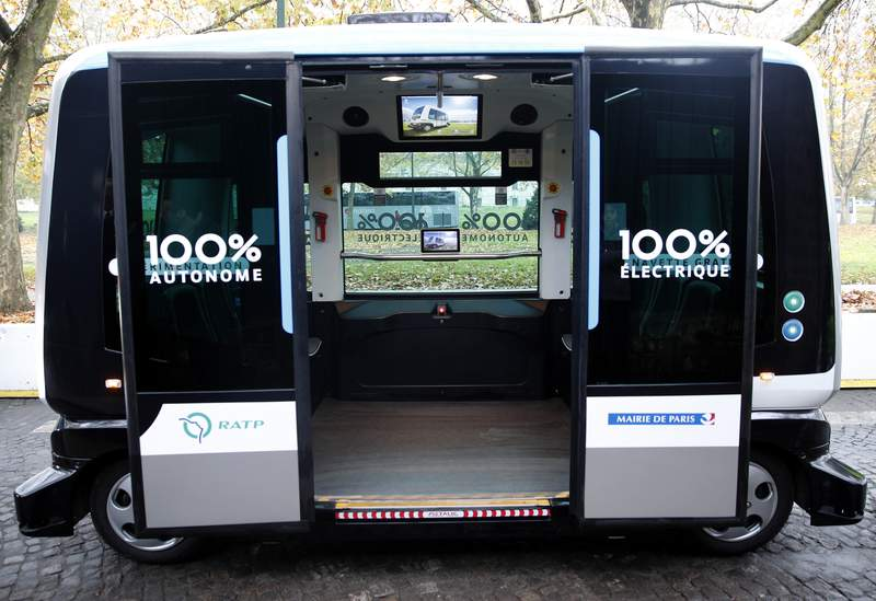 FILE - This Nov. 17, 2017, file photo, shows a view inside an electric driverless shuttle produced by EasyMile, during an experiment, in Paris. The self-driving shuttle service that was ordered to stop carrying passengers in February has been cleared to resume operations with new safety precautions. The U.S. National Highway Traffic Safety Administration told France-based EasyMile to halt passenger operations on low-speed shuttles in 16 U.S. cities after a mysterious braking problem occurred Feb. 20 in Columbus, Ohio. (AP Photo/Christophe Ena, File)
