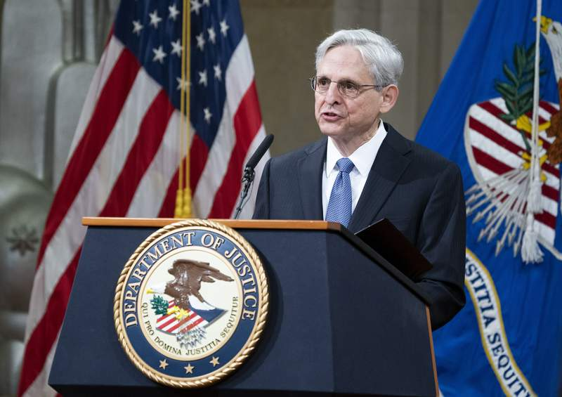 President Joe Biden's pick for attorney general Merrick Garland, addresses staff on his first day at the Department of Justice, Thursday, March 11, 2021,  in Washington. Garland, a one time Supreme Court nominee under President Obama, was confirmed Wednesday by a Senate and will be sworn in later today. (Kevin Dietsch/Pool via AP)