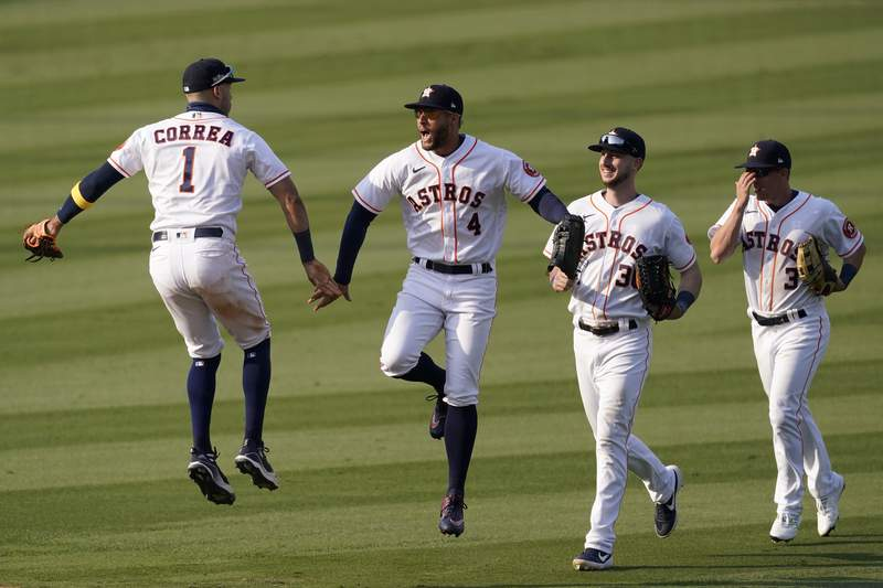 Houston Astros' Carlos Correa, from left, celebrates with George Springer, Kyle Tucker and Myles Straw after the Astros defeated the Oakland Athletics in Game 4 of a baseball American League Division Series in Los Angeles, Thursday, Oct. 8, 2020. (AP Photo/Ashley Landis)