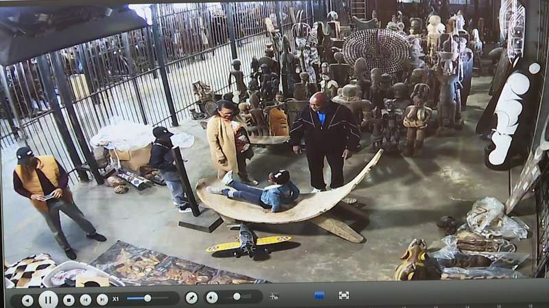 Exclusive surveillance footage obtained by KPRC 2 shows Harris County Commissioner Rodney Ellis interacting multiple times with the massive African art collection stashed in a Harris County maintenance shed.