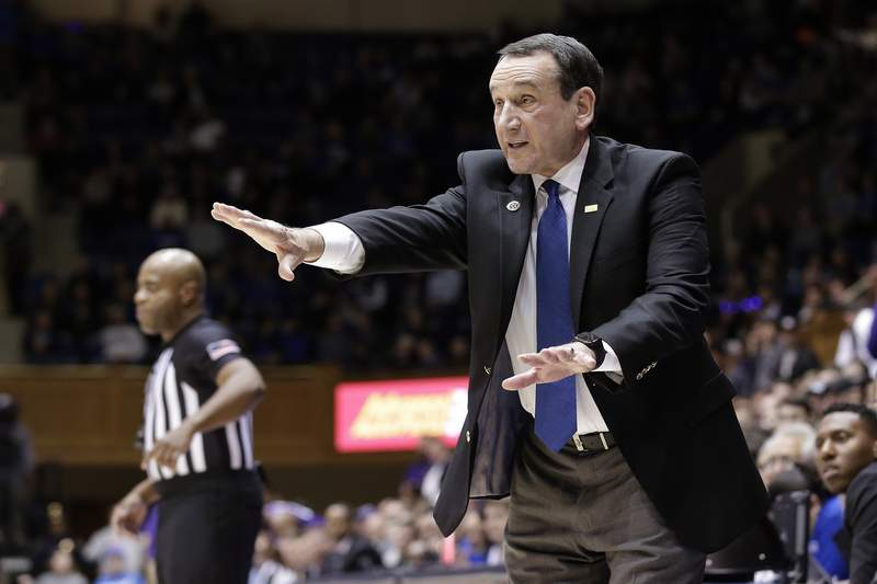 """FILE - In this Nov. 12, 2019, file photo, Duke head coach Mike Krzyzewski reacts to a play during an NCAA college basketball in Durham, N.C. Right now, were asking experts to give us guidance -- life and death in some respects, Krzyzewski said. """"People should pay close attention, he said, or else were not being real smart. (AP Photo/Gerry Broome, File)"""