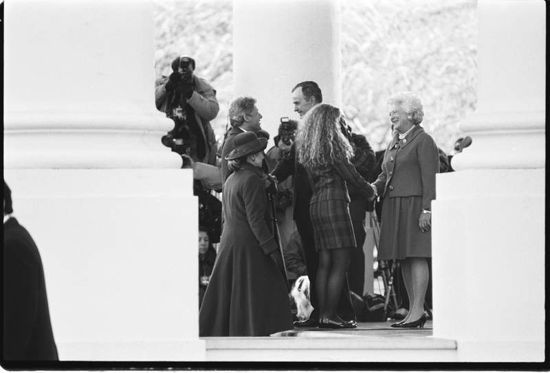 President George HW Bush and First Lady Barbara Bush greet the Clintons as they arrive at the White House before the inauguration of Bill Clinton, 1993.