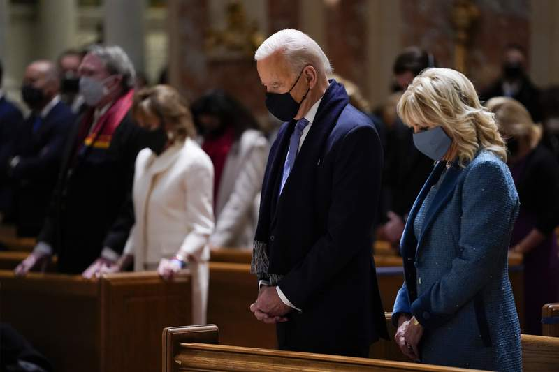 FILE - In this Wednesday, Jan. 20, 2021 file photo, President-elect Joe Biden and his wife, Jill Biden, attend Mass at the Cathedral of St. Matthew the Apostle during Inauguration Day ceremonies in Washington. When U.S. Catholic bishops hold their next national meeting in June 2021, theyll be deciding whether to send a tougher-than-ever message to President Joe Biden and other Catholic politicians: Dont partake of Communion if you persist in public advocacy of abortion rights.(AP Photo/Evan Vucci)