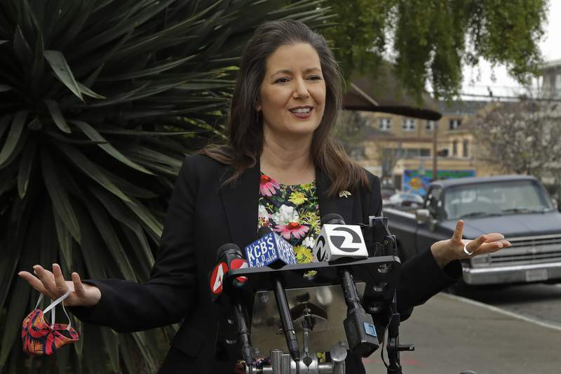 """FILE - In this April 10, 2020, file photo, Oakland Mayor Libby Schaaf speaks at a news conference in Oakland, Calif. Mayor Schaaf on Tuesday, March 23, 2021, announced a privately funded program that will give low-income families of color $500 per month with no rules on how they can spend it. The program in Oakland is the latest example of """"guaranteed income,"""" an idea that giving poor people a set amount of money each month will ease the stresses of poverty that contribute to poor health and hinder their ability to find full-time work. (AP Photo/Ben Margot, File)"""