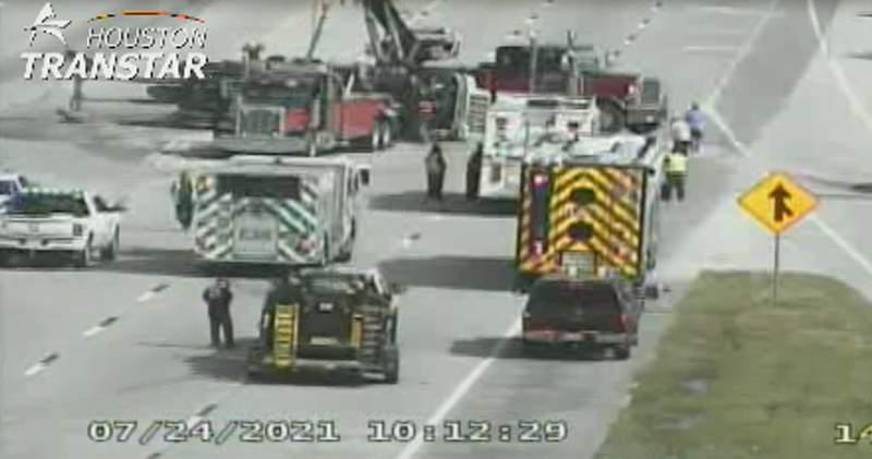 Overturned 18-wheeler shuts down northbound lanes